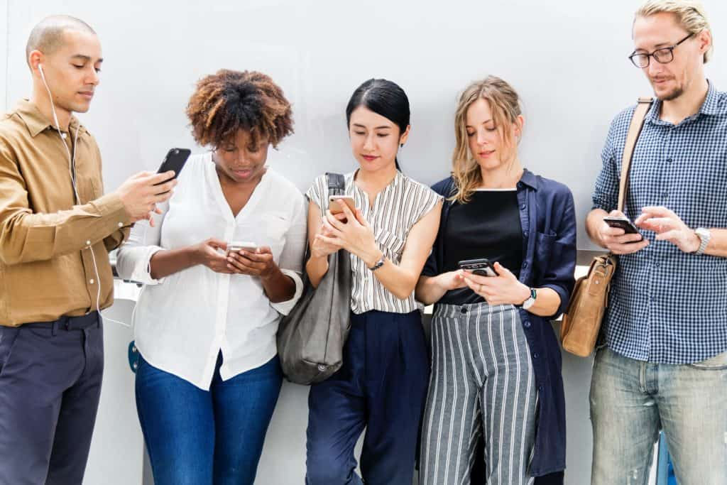 Five people with smartphones